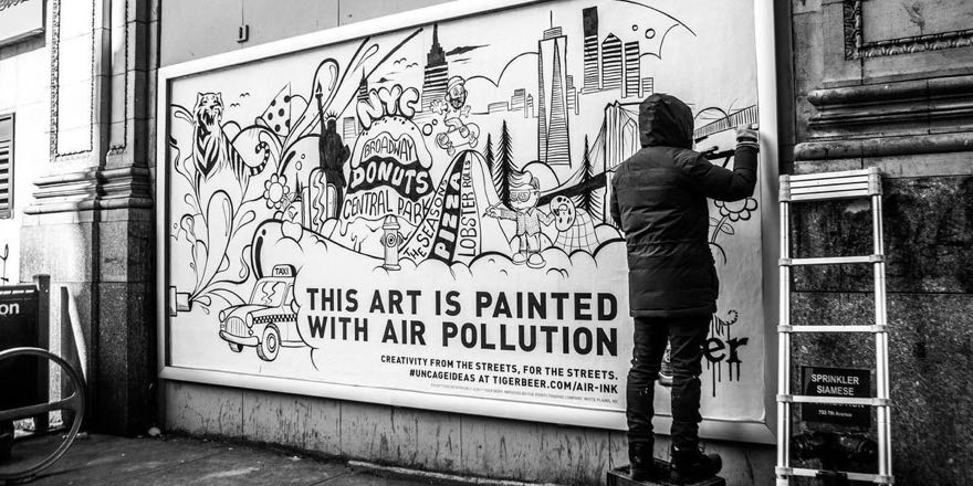 car exhaust printer ink art on a billboard saying 'This art is painted with air pollution'