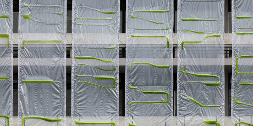 bio-curtain of algae sitting in front of a building