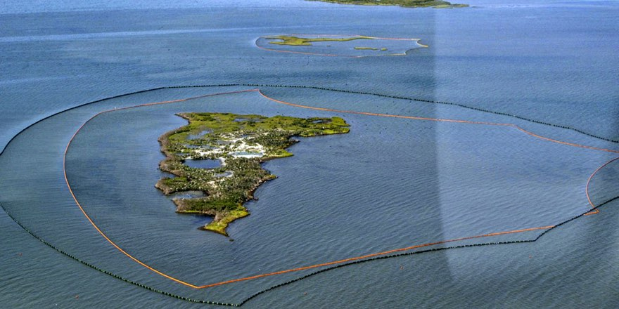 oil spill clean ups with booms around islands