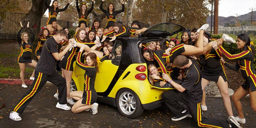 20 cheerleaders being packed into a small car - a Guinness World Recrod