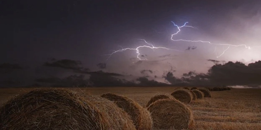 lightning over a farm field