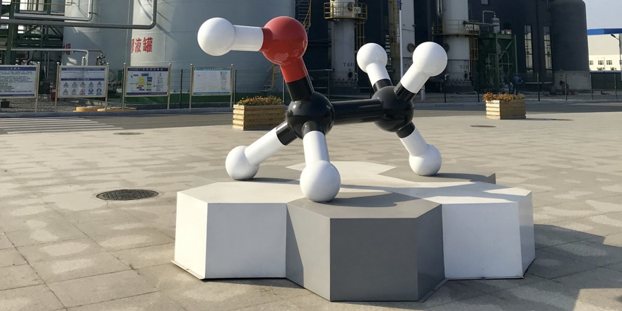 sculpture of carbon molecule outside factory