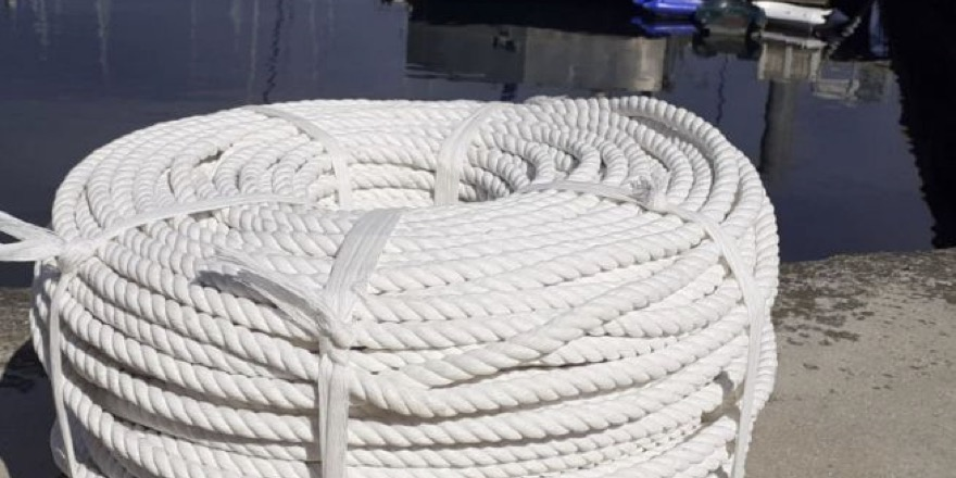 coil of rope beside a dock