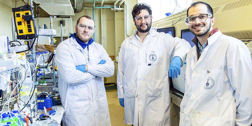 three men in a university laboratory