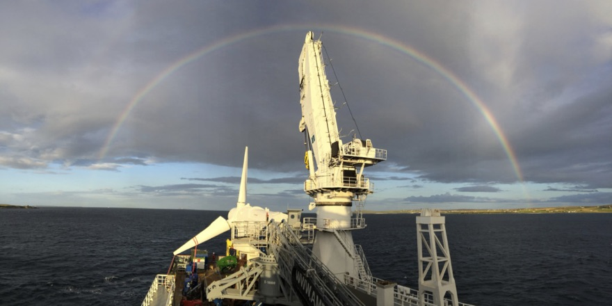 tidal generator project with rainbow above