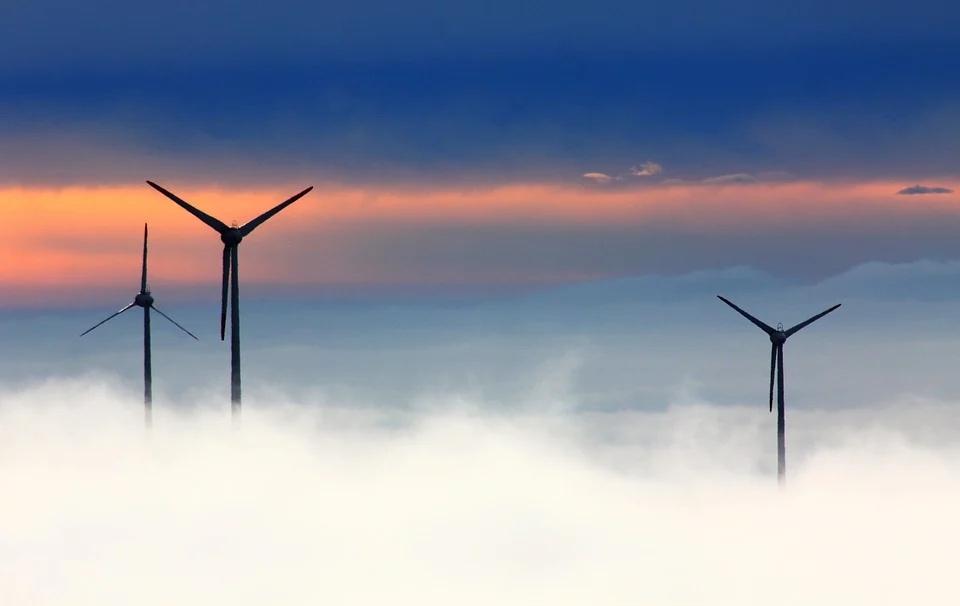 wind turbines in clouds/fog
